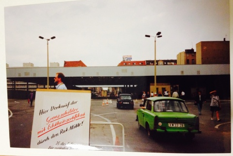 Checkpoint Charlie and the 1950's cars from East Berlin crossing through.
