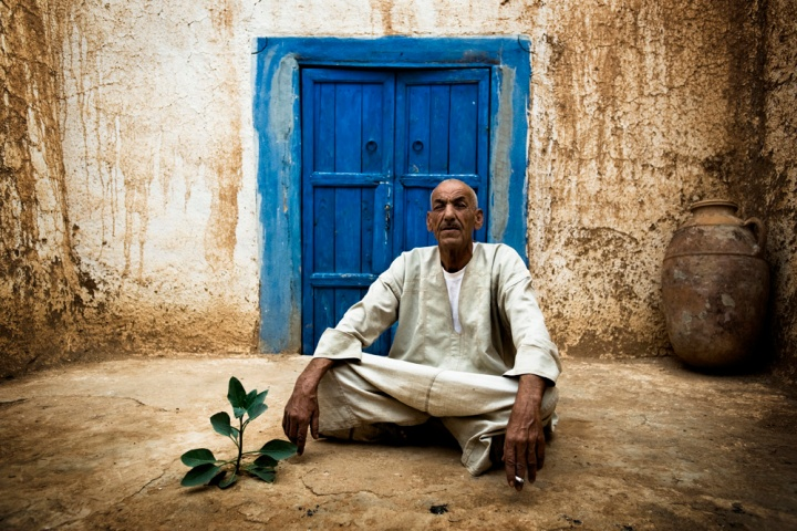 In the small southern Moroccan village of Arazan, Berber Muslim Harim Hamad sits for a portrait in front of the Synagogue which he has been the guardian of since 1962.