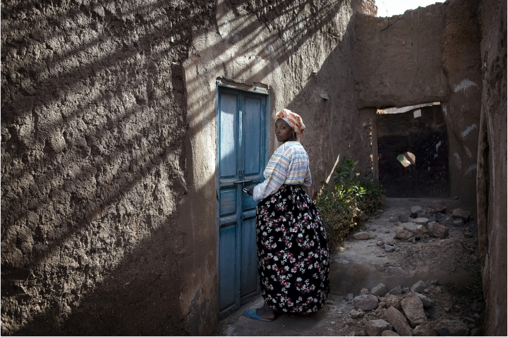 Zubeida 28, opens the door to the synagogue she has been caretaker of since 2002.